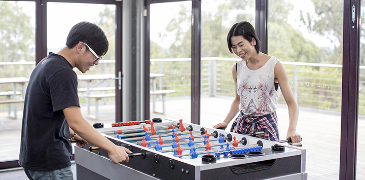 Students playing table football
